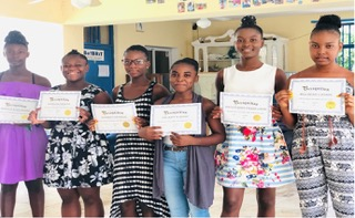 Cosmetology students with their certificates